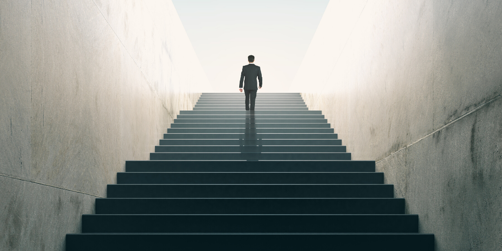 Person walking up a staircase